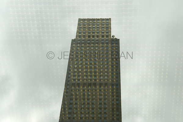 AVAILABLE FOR LICENSING FROM JEFF.<br /> <br /> Rockefeller Center - 30 Rockefeller Plaza (The GE Building) Reflected in a Window of 1251 Avenue of the Americas (Built as the Exxon Building), Midtown Manhattan, New York City, New York State, USA