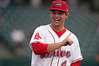 Designated hitter Nick Yorke (4) of the Greenville Drive greets teammates as they are introduced before a game against the Hickory Crawdads on Thursday, August 26, 2021, at Fluor Field at the West End in Greenville, South Carolina. (Tom Priddy/Four Seam Images)