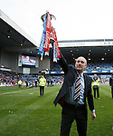 Mark Warburton with the trophy saluting the Rangers fans