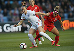 Lucy Bronze of England and Desiree Scott of Canada