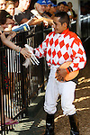 July 29, 2012 Tune Me In, Paco Lopez up, wins the grade III Oceanport Stakes at Monmouth Park Racetrack, Oceanport, NJ. A young fan hands winning jockey Paco Lopez a toy horse for him to autograph after the race. @Joan Fairman Kanes/Eclipse Sportswire