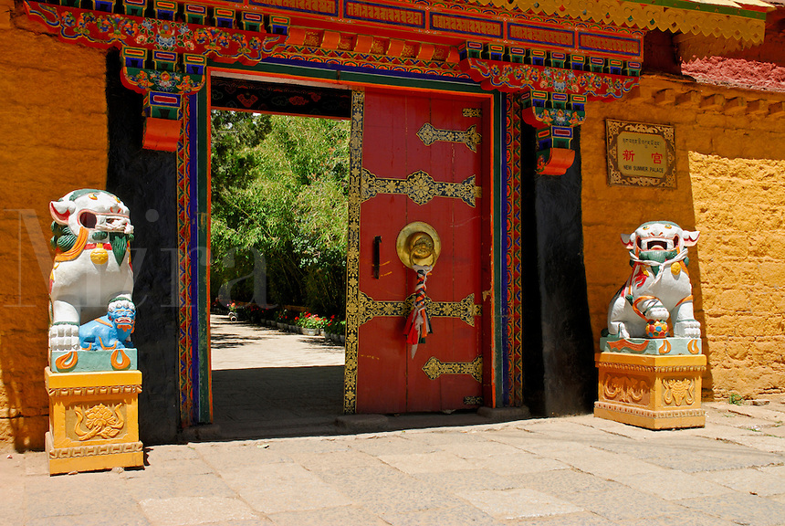 Tibetan national symbols of fearless joy, a pair of now forbidden snow lions,  guard the entrance to the Takten Migyur Potrang, or New Summer Palace of the 14th Dalai Lama, at Norbulingka, founded by the 7th Dalai Lama in 1755, Lhasa, Tibet, China.