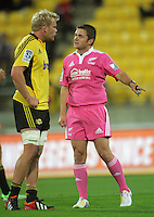 Referee Nick Briant has a chat with Mark Reddish during the Super Rugby match between the Hurricanes and Western Force at Westpac Stadium, Wellington, New Zealand on Friday, 19 April 2013. Photo: Dave Lintott / lintottphoto.co.nz