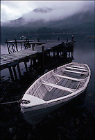 Moored rowboat by pier<br />