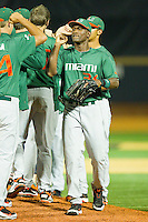 Dale Carey #36 of the Miami Hurricanes celebrates with teammates after they defeated the Wake Forest Demon Deacons 4-1 at Gene Hooks Field on March 18, 2011 in Winston-Salem, North Carolina.  Photo by Brian Westerholt / Four Seam Images