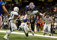 01 January 2010:  Chris Rainey of Florida leaps over Cincinnati defenders before scoring a touchdown during the game against Cincinnati during Sugar Bowl at the SuperDome in New Orleans, Louisiana.  Florida defeated Cincinnati, 51-24.