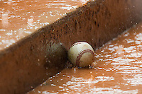 A baseball sits on the dugout steps during a rain delay at Durham Bulls Athletic Park July 18, 2010, in Durham, North Carolina.  Photo by Brian Westerholt / Four Seam Images