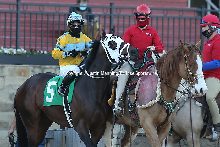 March 6, 2021: Mo Mosa (5) with jockey Martin Garcia aboard before the eighth race at Oaklawn Racing Casino Resort in Hot Springs, Arkansas. ©Justin Manning/Eclipse Sportswire/CSM