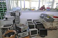 Trezzano sul Naviglio (Milano) - Ri-MAFLOW, Cooperativa Sociale ONLUS fondata all'inizio del 2013 dai lavoratori licenziati di MAFLOW  e di altre aziende in chiusura, oltre che da precari, disoccupati e pensionati, sorta nei capannoni del vecchio sito industriale chiuso alla fine del 2012; fra le varie attività di Ri-Maflow il laboratorio perla riparazione e il ricondizionamento di computer obsoleti<br /> <br /> Trezzano sul Naviglio (Milan) - Re-MAFLOW, Social Cooperative Onlus founded in early 2013 by the dismissed workers of MAFLOW and other companies in closing, as well as temporary workers, unemployed and pensioners, bornin the sheds of the old industrial site closed at the end of 2012; between the various activities of Re-Maflow the laboratory for the repair and reconditioning of obsolete computers