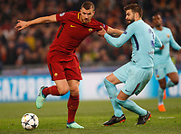 Roma s Edin Dzeko, left, is fouled by FC Barcelona Gerard Pique during the Uefa Champions League quarter final second leg football match between AS Roma and FC Barcelona at Rome's Olympic stadium, April 10, 2018.<br /> UPDATE IMAGES PRESS/Riccardo De Luca
