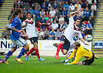 St Johnstone v FC Minsk...08.08.13 Europa League Qualifier<br /> Siarhei Sasnouski manages to clear the ball over the crossbar as keeper Vladzimir Bushma misses the ball<br /> Picture by Graeme Hart.<br /> Copyright Perthshire Picture Agency<br /> Tel: 01738 623350  Mobile: 07990 594431