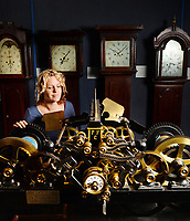 BNPS.co.uk (01202 558833)<br /> Pic: ZacharyCulpin/BNPS<br /> <br /> Laura Whatmoor with an incredibly intricate French Turret Clock which dates back to 1900.<br /> <br /> This may take some time....<br /> <br /> Laura Whatmoor at the Dorset Collection of Clocks faces a busy time of it. With the clocks going back an hour this Sunday, staff at the visitor attraction in Owermoigne will have to adjust over hundred clocks. <br /> <br /> The collection dates back to 1700 and includes a varied range of Grandfather clocks and Turret Church clocks.
