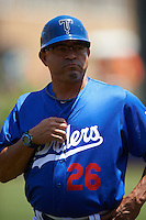 Tulsa Drillers coach Leo Garcia (26) during a game against the Midland RockHounds on June 3, 2015 at Oneok Field in Tulsa, Oklahoma.  Midland defeated Tulsa 5-3.  (Mike Janes/Four Seam Images)