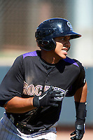 Colorado Rockies minor league infielder Cristhian Adames #12 during an instructional league intrasquad game at the Salt River Flats Complex on October 5, 2012 in Scottsdale, Arizona.  (Mike Janes/Four Seam Images)