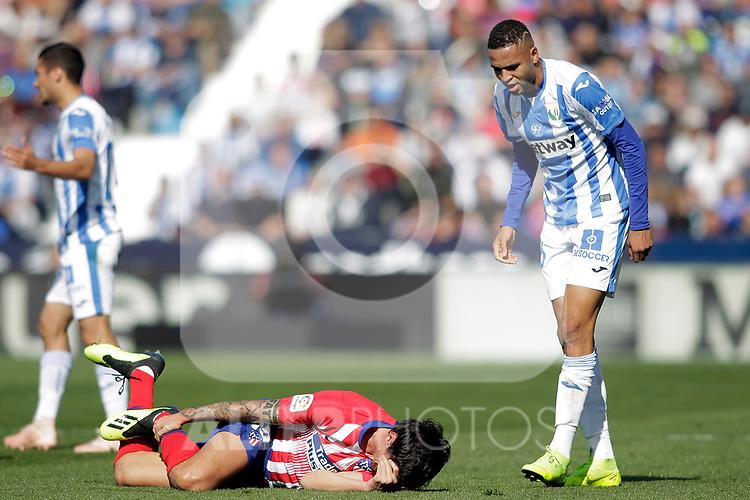 CD Leganes' Youssef En-Nesyri (r) have words with Atletico de Madrid's Stefan Savic injured during La Liga match. November 3,2018. (ALTERPHOTOS/Acero)