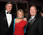 From left: Todd and Sarah Sullivan with Gerry Del Prete at a private party aboard the Fertitta's yacht before the San Luis Salute in Galveston Friday  Feb. 08, 2013.(Dave Rossman/ For the Chronicle)