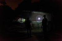 """Das ehemalige St. Josefsheim Waldniel-Hostert, Fuehrung durch das Heim mit der Kentschool Security Group, [das Josefsheim ist ein ehemaliges Franziskaner-Heim fuer Kinder mit Behinderung, nach 1937 war es die Kinderfachabteilung der Provinzial Heil- und Pflegeanstalt, in dieser Zeit wurden ca. 100 Kindern mit Behinderung durch die Nationalsozialisten ermordet, von 1963 bis 1991 britische Kent-School], heute leerstehende Ruine, [Treffpunkt fuer """"Geisterjaeger""""], Nacht, Nachtaufnahme, Taschenlampe, Gitter, unheimlich, gruselig, lost place, lost places, moderne Ruine, Grundstueck, Verfall, verfallen, Gedenkstaette, Euthanasie, Kindereuthanasie, Naziverbrechen, Verbrechen, Behinderung, Nationalsozialismus, Nazi-Zeit, Drittes Reich, Geschichte, Historie, Josefs-Heim, Europa, Deutschland, Nordrhein-Westfalen, Viersen, Schwalmtal, 08/2013<br /> <br /> Engl.: Europe, Germany, North Rhine-Westphalia, Viersen, Schwalmtal, former St. Josefsheim Waldniel-Hostert, guided tour through the home with the Kentschool Security Group, building, exterior view, fence, ruin, night, memorial site, euthanasia, mercy killing, crime, disability, National Socialism, Third Reich, history, the Josefsheim is a former home managed by Franciscan monks for disabled children, after 1937 the National Socialists killed approx. 100 disabled children there, from 1963 - 1991 British Kent-School, August 2013"""