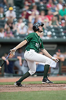 Great Lakes Loons designated hitter Cody Thomas (25) follows through on his swing against the Bowling Green Hot Rods during the Midwest League baseball game on June 4, 2017 at Dow Diamond in Midland, Michigan. Great Lakes defeated Bowling Green 11-0. (Andrew Woolley/Four Seam Images)