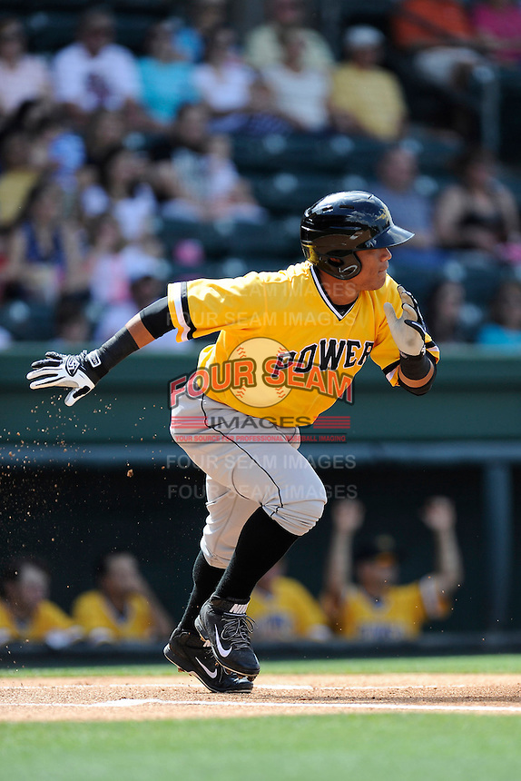 Center fielder Harold Ramirez (32) of the West Virginia Power in a game against the Greenville Drive on Sunday, May 11, 2014, at Fluor Field at the West End in Greenville, South Carolina. Ramirez is the No. 9 prospect of the Pittsburgh Pirates, according to Baseball America. Greenville won, 9-6. (Tom Priddy/Four Seam Images)