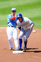 Pawtucket Red Sox second baseman Sean Coyle (3) turns a double play,as Durham Bulls right fielder Mikie Mahtook (7) watches,  during a game versus the Durham Bulls at McCoy Stadium in Pawtucket, Rhode Island on May 3, 2015.  (Ken Babbitt/Four Seam Images)