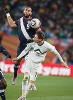 The USA's Oguchi Onyewu fights for a loose ball with Slovenia's  Milivoje Novakovic in the second half of the 2010 World Cup match between USA and Slovenia at Ellis Park Stadium in Johannesburg, South Africa on Friday, June 18, 2010.  The USA tied Slovenia 2-2.