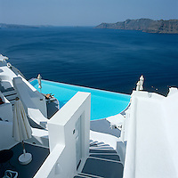 Steps wind down to an infinity pool with a view of over the Mediterranean