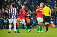 Saturday, 9 March 2013<br /> <br /> Pictured: Garry Monk of Swansea City talks with Referee Lee Mason <br /> <br /> Re: Barclays Premier League West Bromich Albion v Swansea City FC  at the Hawthorns, Birmingham, West Midlands