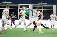 FOXOBOROUGH, MA - AUGUST 21: Adam Buksa #9 of New England Revolution and Geoff Cameron #12 of FC Cincinnati battle for the ball during a game between FC Cincinnati and New England Revolution at Gillette Stadium on August 21, 2021 in Foxoborough, Massachusetts.