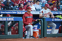 Arkansas Razorbacks pitching coach Matt Hobbs watches from the dugout during the game against the Oklahoma Sooners in game two of the 2020 Shriners Hospitals for Children College Classic at Minute Maid Park on February 28, 2020 in Houston, Texas. The Sooners defeated the Razorbacks 6-3. (Brian Westerholt/Four Seam Images)