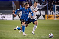 SAN JOSE, CA - MAY 01: Cade Cowell #44 of the San Jose Earthquakes passes Frederic Brillant #13 of DC United with the ball during a game between San Jose Earthquakes and D.C. United at PayPal Park on May 01, 2021 in San Jose, California.