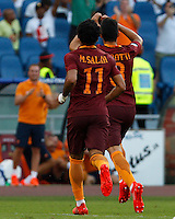Calcio, Serie A: Roma vs Udinese. Roma, stadio Olimpico, 20 agosto 2016.<br /> Roma's Diego Perotti, right, celebrates with teammate Mohamed Salah after scoring on a penalty kick during the Italian Serie A football match between Roma and Udinese at Rome's Olympic Stadium, 20 August 2016. Roma won 4-0.<br /> UPDATE IMAGES PRESS/Riccardo De Luca