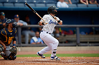 Biloxi Shuckers Cooper Hummel (9) hits a single during a Southern League game against the Montgomery Biscuits on May 8, 2019 at MGM Park in Biloxi, Mississippi.  Biloxi defeated Montgomery 4-2.  (Mike Janes/Four Seam Images)