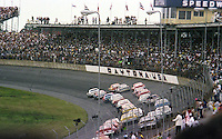 The green flag waves to start  the Firecracker 400 at Daytona International Speedway in Daytona Beach, Florida on July 4, 1977. (Photo by Brian Cleary/www.bcpix.com)