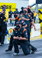 Aug 9, 2020; Clermont, Indiana, USA; Andrew Hines (center) and crew members for NHRA pro stock motorcycle rider Angelle Sampey celebrate after winning the Indy Nationals at Lucas Oil Raceway. Mandatory Credit: Mark J. Rebilas-USA TODAY Sports