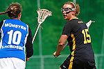 GER - Hannover, Germany, May 30: During the Women Lacrosse Playoffs 2015 match between Muenster Mohawks (blue) and HTHC Hamburg (black) on May 30, 2015 at Deutscher Hockey-Club Hannover e.V. in Hannover, Germany. Final score 9:20. (Photo by Dirk Markgraf / www.265-images.com) *** Local caption *** Jennifer Karle #15 of HTHC Hamburg, Judith van Oepen #10 of Muenster Mohawks