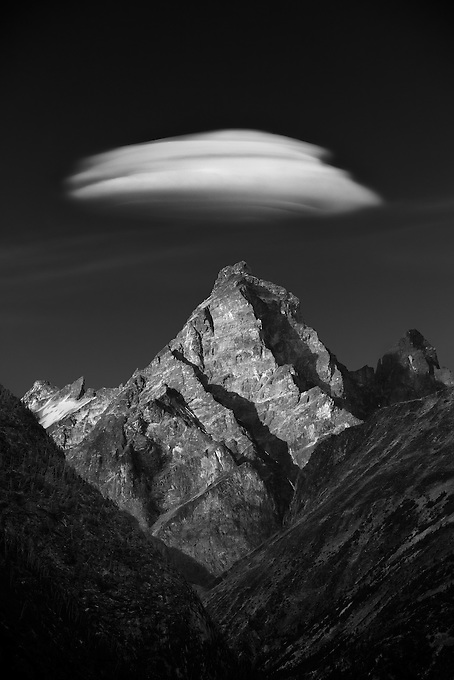 A lenticular cloud forms over this unnamed jagged peak in the late afternoon.<br /> Artist Edition: 15/100 Limited
