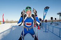 4860<br /> <br /> Tour of Anchorage 50k men's winner Jack Novak (2001) rests after winning the  race Sunday, March 4, 2018.  Photo by Michael Dinneen  / www.dinneenphoto.com