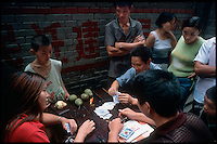 Fengdu, China, August 2003.Card players and prostitutes in the old city of Fengdu.
