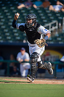 Northwest Arkansas Naturals catcher Meibrys Viloria (22) chases a runner during a Texas League game between the Northwest Arkansas Naturals and the Arkansas Travelers on May 30, 2019 at Arvest Ballpark in Springdale, Arkansas. (Jason Ivester/Four Seam Images)