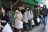 Queuing for food in Sendai, Japan. After the eartquake and tsunami a nuclear reactor exploded adding to woories of radiation spreading from the plant. The International Atomic Energy Agency confirmed that three reactors has partially melted down. Tens of thousands of people have been evacuated around the fukushima Daiichi plant..15 Mar 2011..