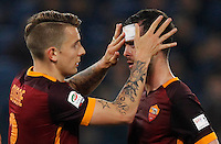 Calcio, Serie A: Roma vs Inter. Roma, stadio Olimpico, 19 marzo 2016.<br /> Roma's Miralem Pjanic, right, is helped by teammate Lucas Digne after getting injured during the Italian Serie A football match between Roma and FC Inter at Rome's Olympic stadium, 19 March 2016. The game ended 1-1.<br /> UPDATE IMAGES PRESS/Riccardo De Luca