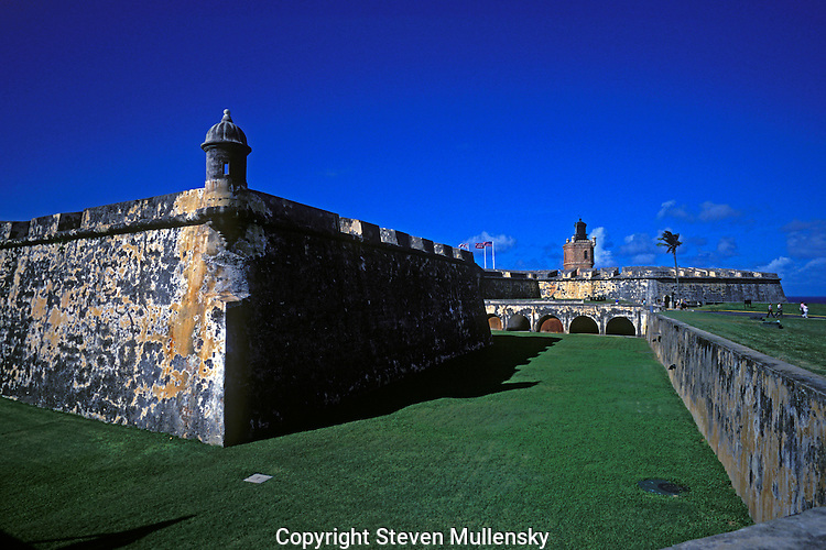 """Fort San Felipe del Morro ?or El Castillo San Felipe del Morro in Spanish? is a sixteenth-century citadel which lies on the northwestern-most point of the islet of San Juan, Puerto Rico. Named in honor of King Philip II of Spain, the fort, also referred to as """"El Morro"""" or """"promontory"""", was designed to guard the entrance to San Juan bay, and defend the city of San Juan from seaborne enemies...In 1983, the fort was declared a World Heritage Site by the United Nations and is part of San Juan National Historic Site. Over two million visitors a year explore the windswept ramparts and passageways making the fort one of Puerto Rico's main visitor attractions."""
