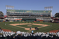 OAKLAND, CA - SEPTEMBER 29:  Lucas Giolito #27 of the Chicago White Sox pitches in this wide angle interior view against the Oakland Athletics during Wild Card Round Game One at the Oakland Coliseum on Tuesday, September 29, 2020 in Oakland, California. (Photo by Brad Mangin)