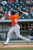 Henry Urrutia (51) of the Norfolk Tides follows through on his swing against the Charlotte Knights at BB&T BallPark on April 20, 2016 in Charlotte, North Carolina.  The Knights defeated the Tides 6-3.  (Brian Westerholt/Four Seam Images)