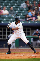 NW Arkansas Naturals outfielder Jorge Bonifacio (24) at bat during a game against the San Antonio Missions on May 30, 2015 at Arvest Ballpark in Springdale, Arkansas.  San Antonio defeated NW Arkansas 5-1.  (Mike Janes/Four Seam Images)