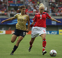Chill·n, Chile: Americanís  forward,  Alex Morgan goes for the ball along with Stephanie Houghton England¥s team, during the  quarters-finals match, of the Fifa U-20 Womens World Cup the at Nelson Oyarz˙n stadium in Chill·n, on November 30, 2008. Photo by Grosnia / ISIphotos.com