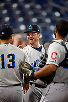 Lake County Captains manager Larry Day (27) celebrates with Li-Jen Chu (13) and Juan De La Cruz (20) after a game against the Quad Cities River Bandits on May 6, 2017 at Modern Woodmen Park in Davenport, Iowa.  Lake County defeated Quad Cities 13-3.  (Mike Janes/Four Seam Images)