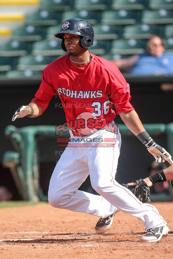 Oklahoma City RedHawks right fielder Jimmy Paredes (36) at bat during the Pacific Coast League game against the Oklahoma City RedHawks at Chickashaw Bricktown Ballpark on June 23, 2013 in Oklahoma City ,Oklahoma.  (William Purnell/Four Seam Images)
