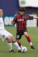New England Revolution's Joe Franchino takes the ball from the MetroStars' Joselito Vaca. The New England Revolution played the NY/NJ MetroStars to a 1 to 1 tie at Giant's Stadium, East Rutherford, NJ, on April 25, 2004.
