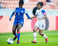HOUSTON, TX - JANUARY 31: Ruthny Mathurin #4 of Haiti and Shirley Cruz #10 of Costa Rica contest the ball during a game between Haiti and Costa Rica at BBVA Stadium on January 31, 2020 in Houston, Texas.
